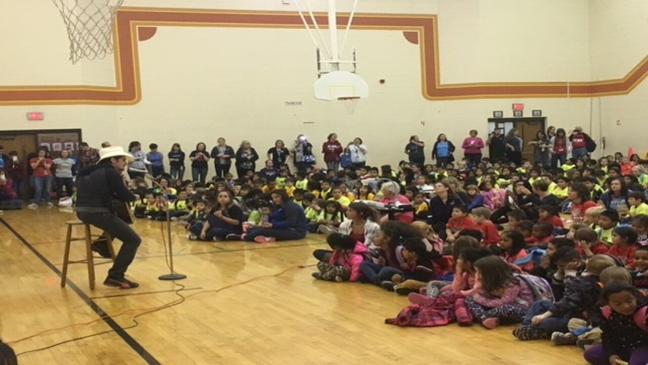 Watch: Country star surprises school with visit