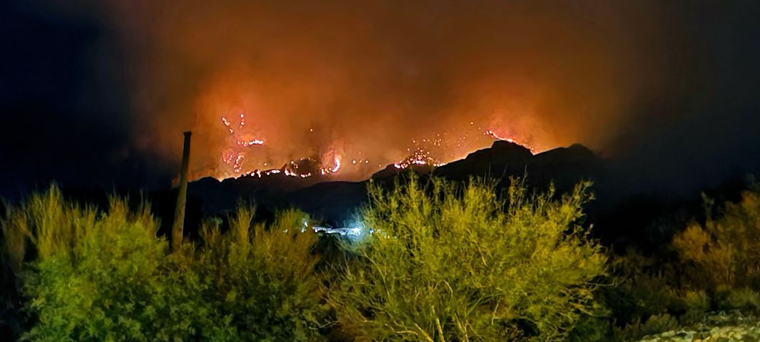 The Bighorn Fire rages on in the Catalina Mountains as seen here from residential streets just outside the evacuation zone
