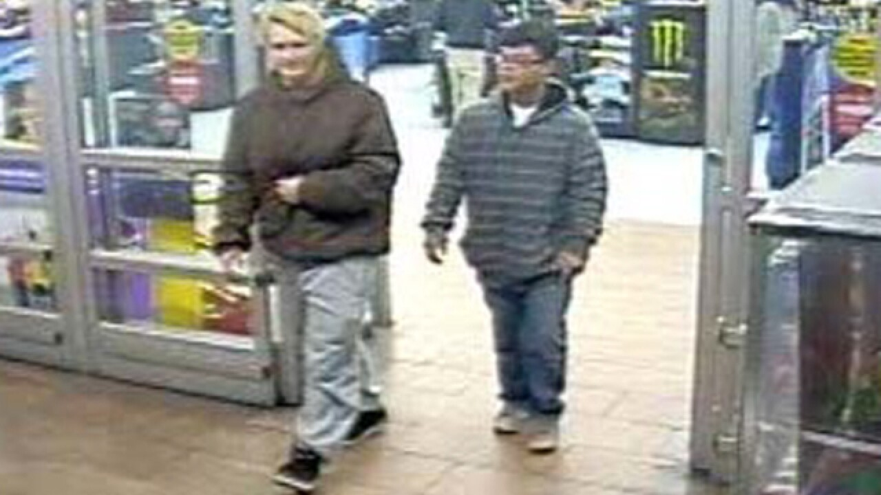 Men sought for stealing credit card out of car