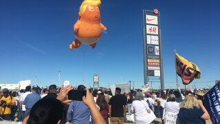 Protesters, Baby Trump balloon greet President Trump during San Diego visit