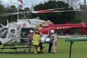 Paramedics load an alligator bite victim into a helicopter at Halpatiokee Regional Park in Stuart on July 19, 2021.jpg