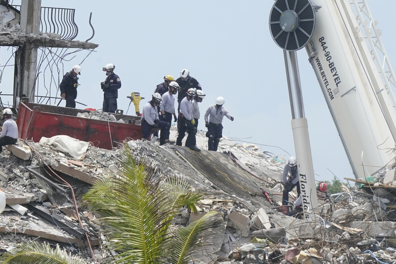 Rescuers cut into slab of concrete at Champlain Towers South condo collapse site, June 28, 2021
