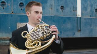 Pueblo West High School senior Colby Kleven playing his french horn. Photo courtesy of Jennifer Kleven.