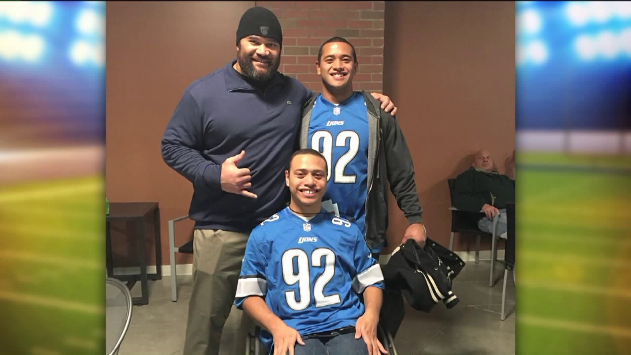 Pro football player selects Utah brothers to attend Detroit Lions game