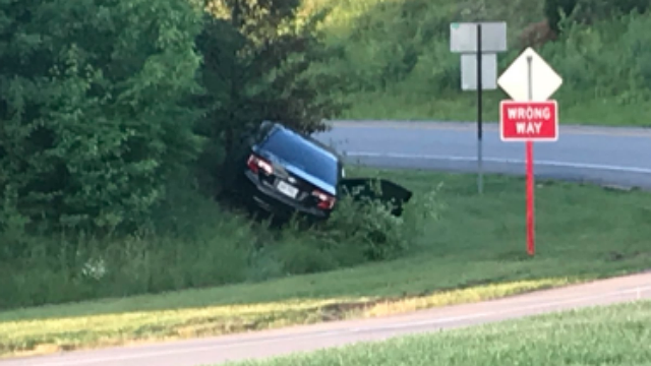 Car fleeing police goes wrong way, crashes