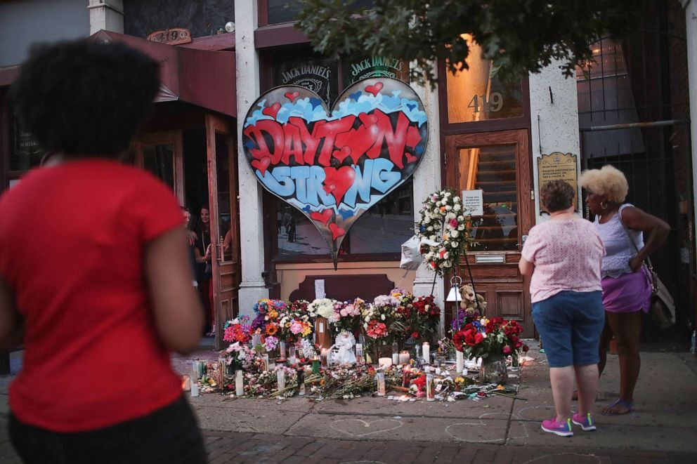 People congregate around a memorial to those killed in Sunday morning's mass shooting on Aug. 6, 2019 in Dayton, Ohio (Scott Olson/Getty Images).