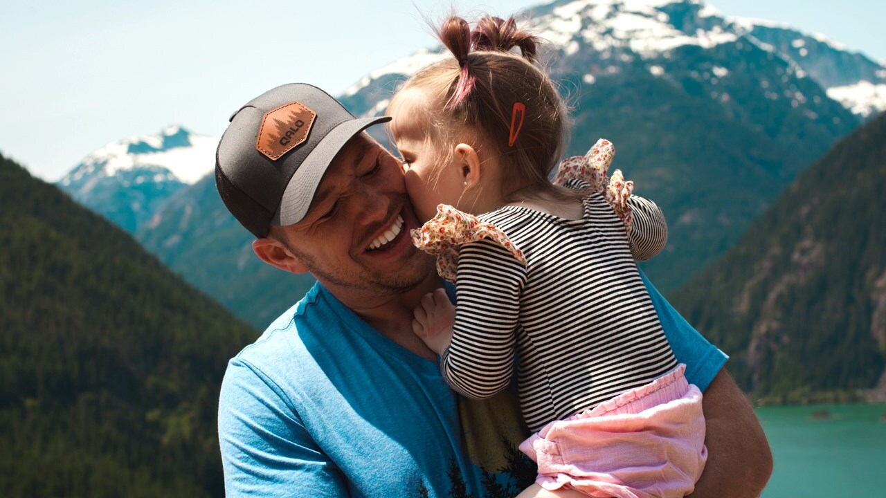 man smiling holding daughter file photo, happy smile smiles happiness family father dad.jpg
