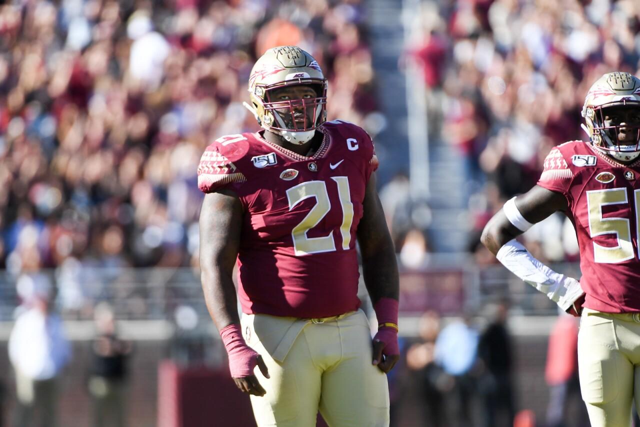 Florida State Seminoles defensive tackle Marvin Wilson looks at scoreboard vs Miami in 2019