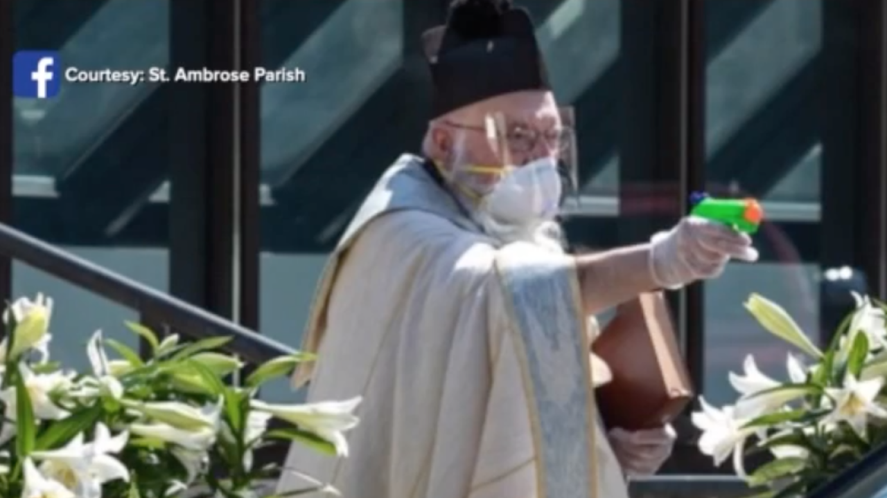 Detroit priest uses squirt gun to shoot holy water so he can bless people at safe social distance