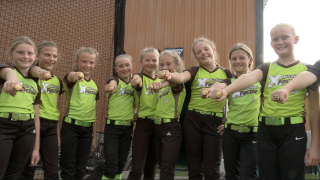 X Factor 9u softball of Jenison shows off state championship rings