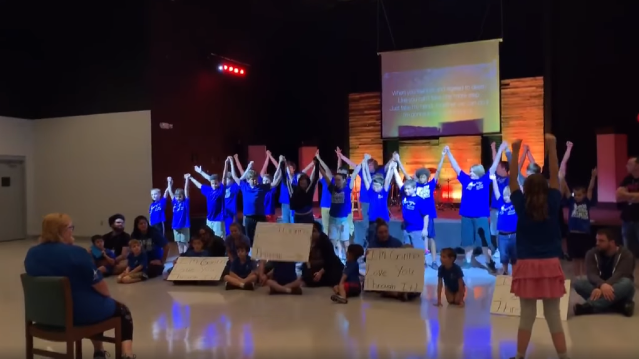 Special needs students at Florida school perform song in support of school secretary recently diagnosed with cancer