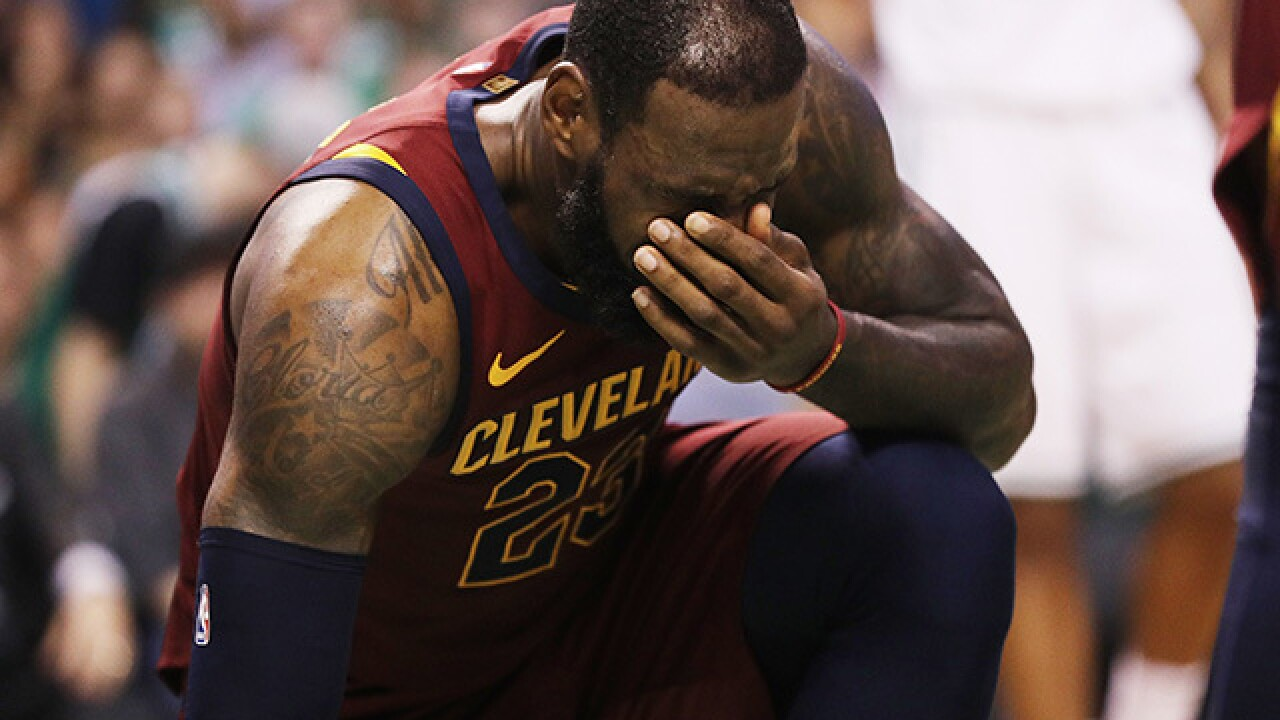 Cavs star James goes to locker room after shot to jaw