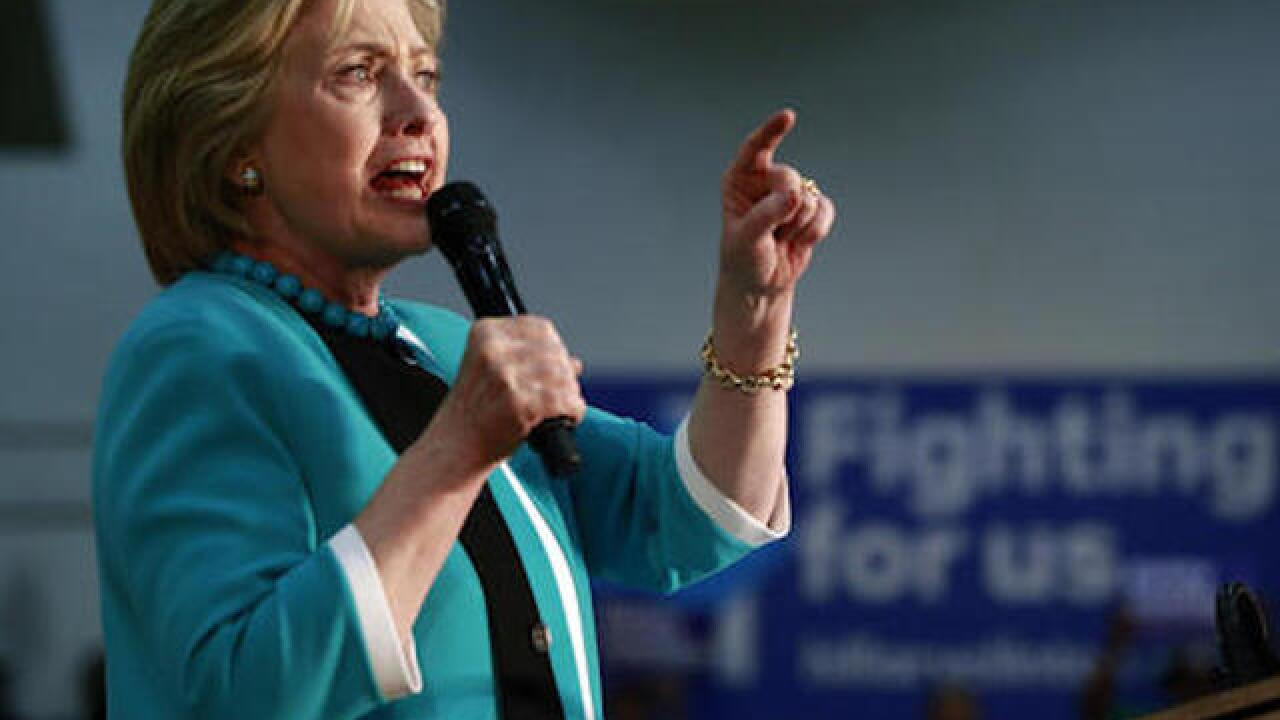 Democrats searching for unity as Clinton locks up nomination