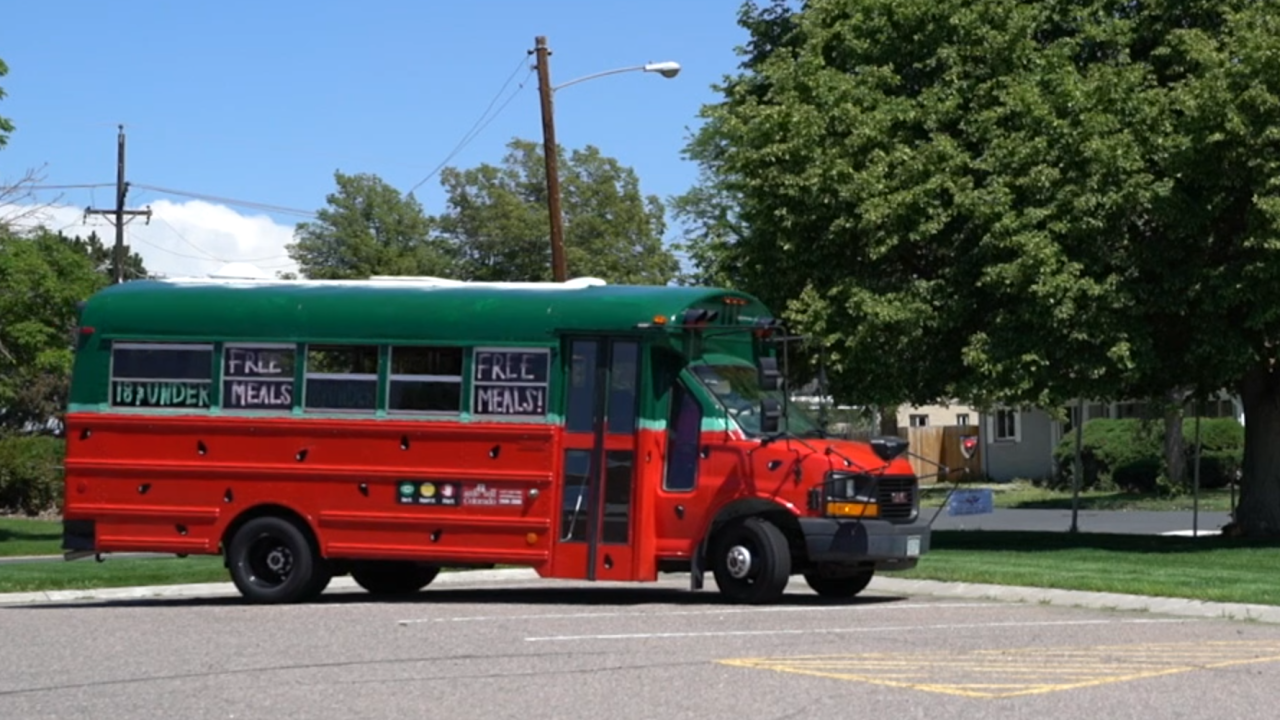 School district turns old buses into mobile cafes to feed students during summer