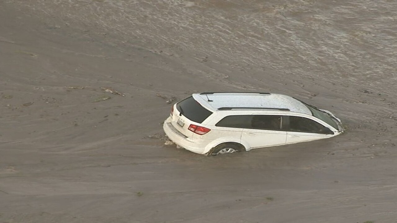 FD: Person stuck inside vehicle in floodwaters