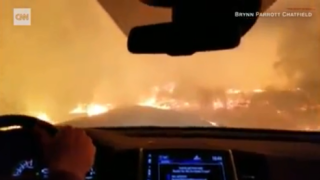 Caught on cam: Family prays while driving through California wildfire