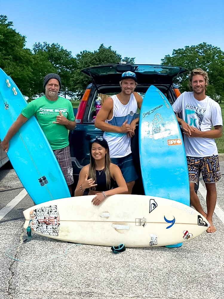 Pictured in middle: Chris Kish and Cat Carrillo, with another local surfers.