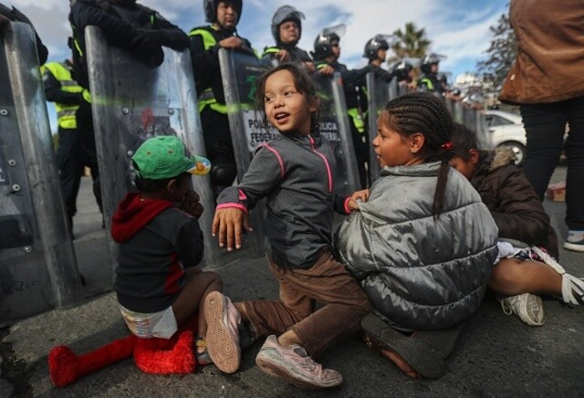 Migrant caravan awaits next step