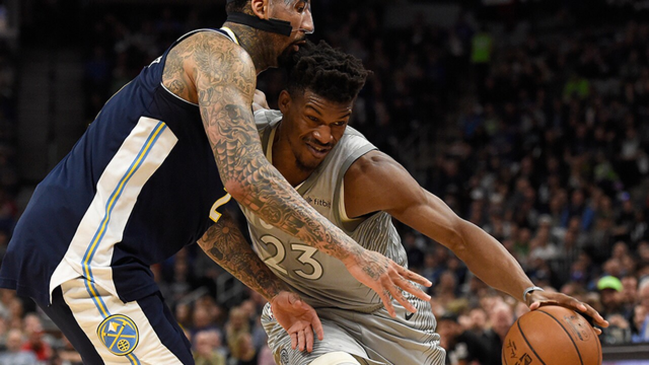 Butler, Towns lead T-wolves past Nuggets in OT, to playoffs