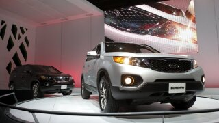 Kia recalls SUVs, vans; electrical problem can cause fires