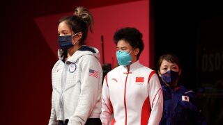 USA's Delacruz unable to complete lift, Hou wins gold with Olympic record