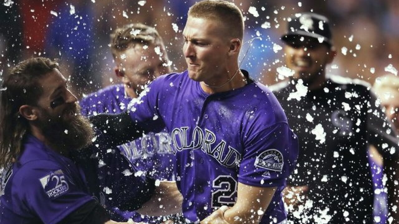 Ryan McMahon hit a 3-run home run with two outs in the 9th inning as the Rockies beat the Dodgers