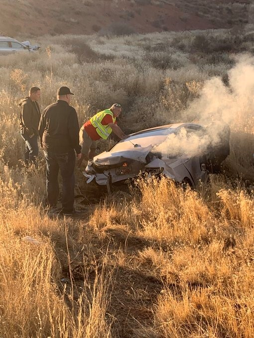 Photos: SLC's Assistant Police Chief hailed as hero for pulling man from burningcar