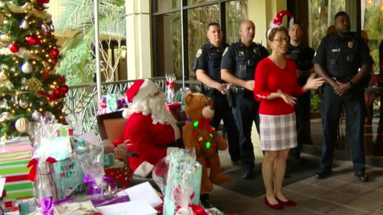 Children from Puerto Rico living in Palm Beach Gardens receive visit from Santa