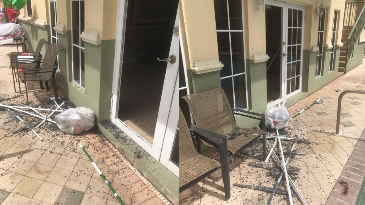 wptv-broken-glass-door-072019.jpg