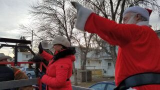 Santa Claus and helpers deliver gifts to Great Falls children
