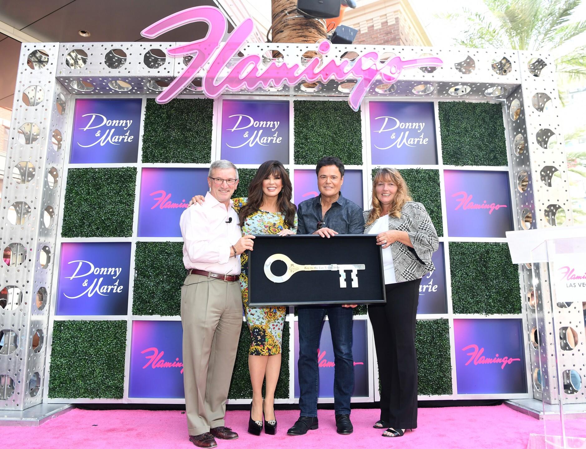 (L-R) Caesars Entertainment CEO Tony Rodio, Donny & Marie, Clark County Commission Chairwoman Marilyn Kirkpatrick; Key to the Las Vegas Strip at Flamingo Las Vegas_6.JPG