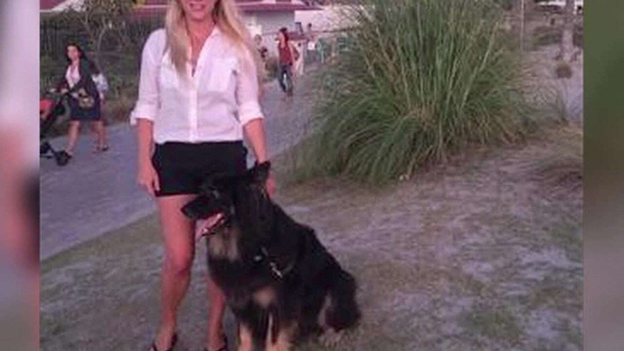 Woman says dog killed by officers' stun guns