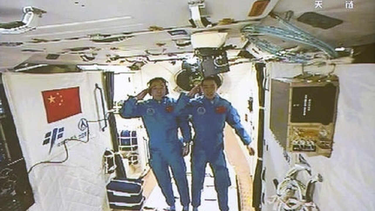 Chinese astronauts enter space station after docking