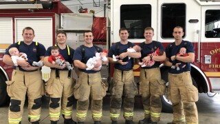 Opelika Fire Department firefighters with babies