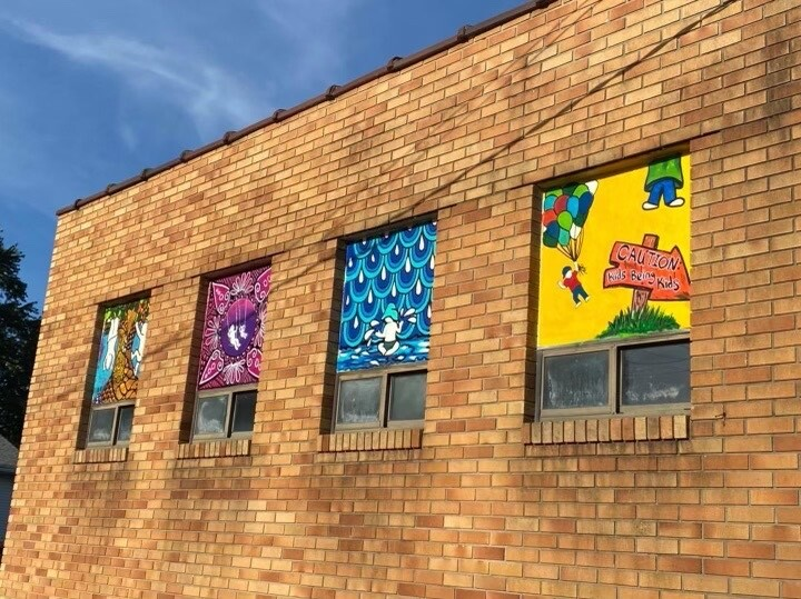Michelle painted the windows of Acres of Play Preschool and Daycare in Charlotte.