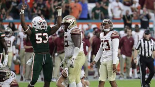 Miami Hurricanes linebacker Zach McCloud celebrates after Florida State Seminoles kicker Ricky Aguayo misses field goal in 2018