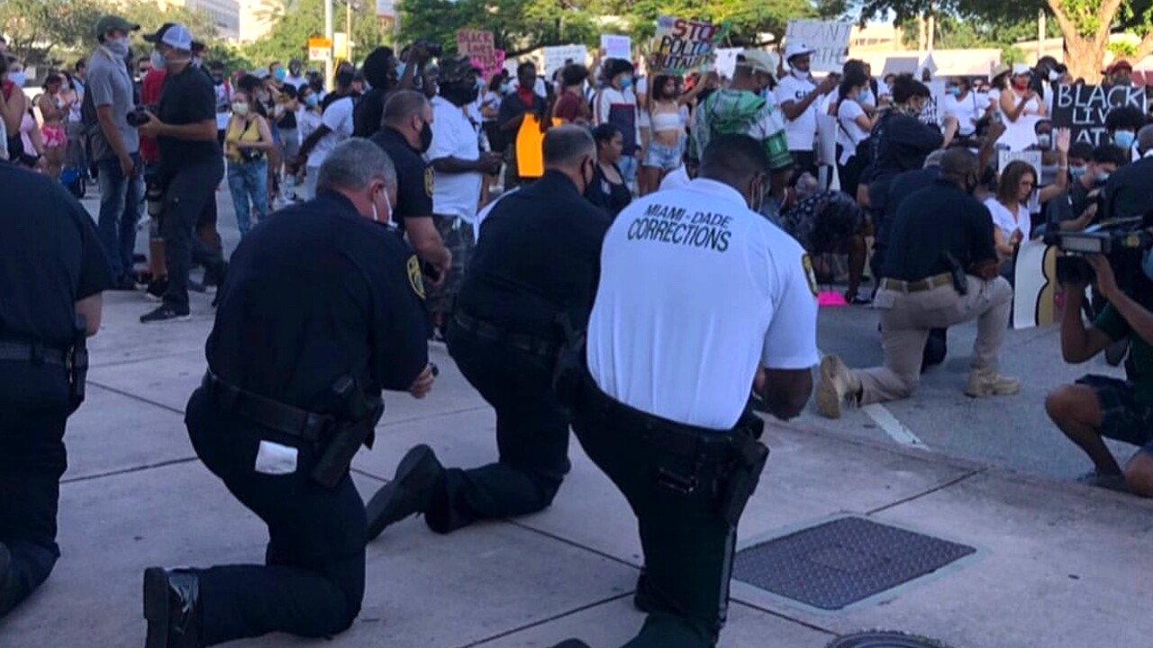 Death of George Floyd: Police, protesters come together to pray in Miami-Dade County