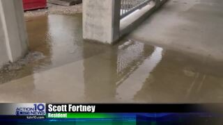 Residents say a brand new walkway is causing flooding, impeding access to an overpass