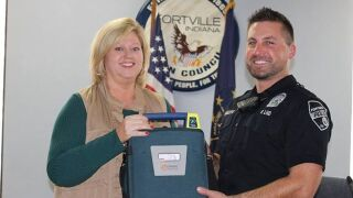 Fortville police gifted AED from non profit Brian's Heart