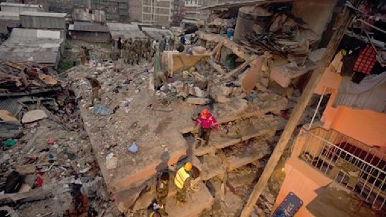 Woman found alive 6 days after building collapse