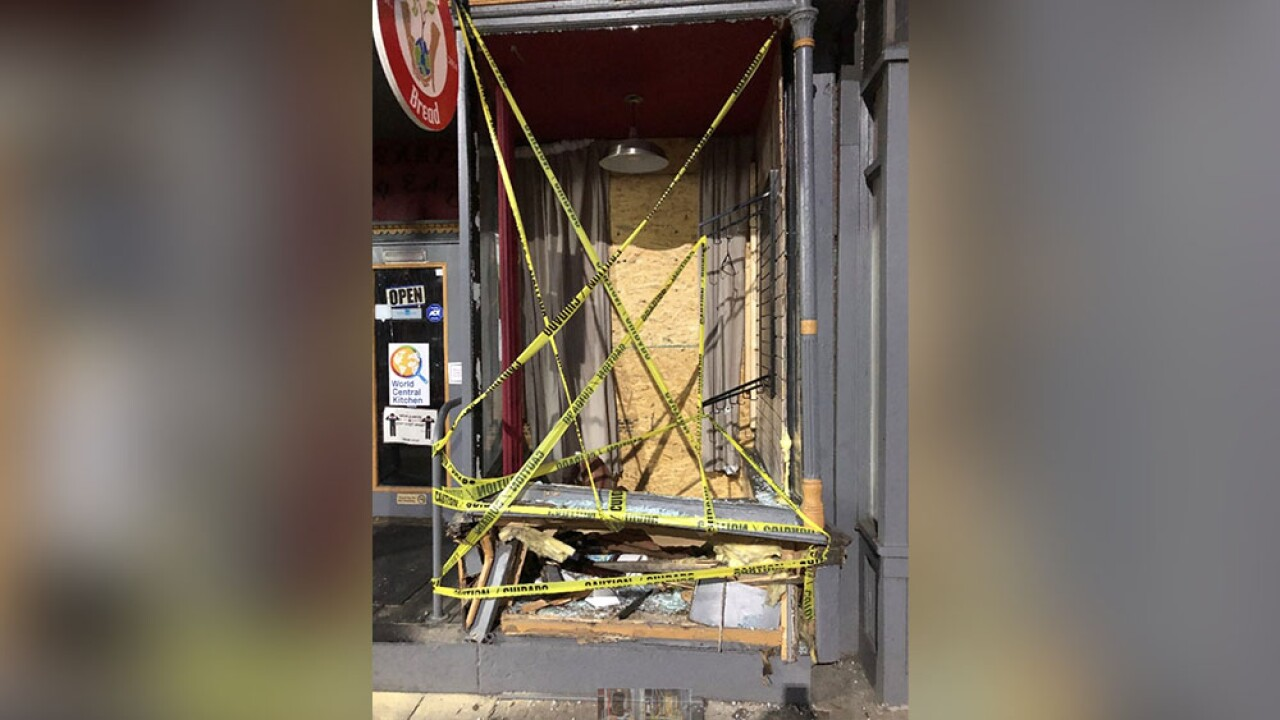 Pigtown open for business despite car driving through storefront 2.jpg