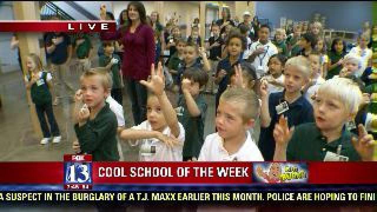 Students do the Pledge of Allegiance in sign language