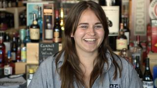 Katie Camlin smiles at Plaza Liquor
