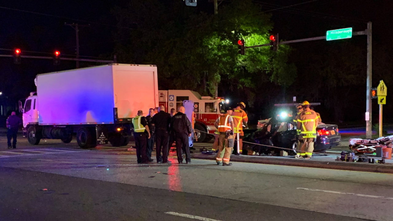 Driver extricated from car, transported with life-threatening