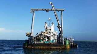 In this July 7, 2019 photo made available by the Bahamas Air Accident Investigation Department, the wreckage of a Augusta SPA helicopter is recovered off the coast of Grand Cay, in the Abacos, Bahamas. Coal billionaire Chris Cline and six other Americans died in the crash on July 4, 2019, as they were departing the Bahamas towards Fort Lauderdale, Fla.