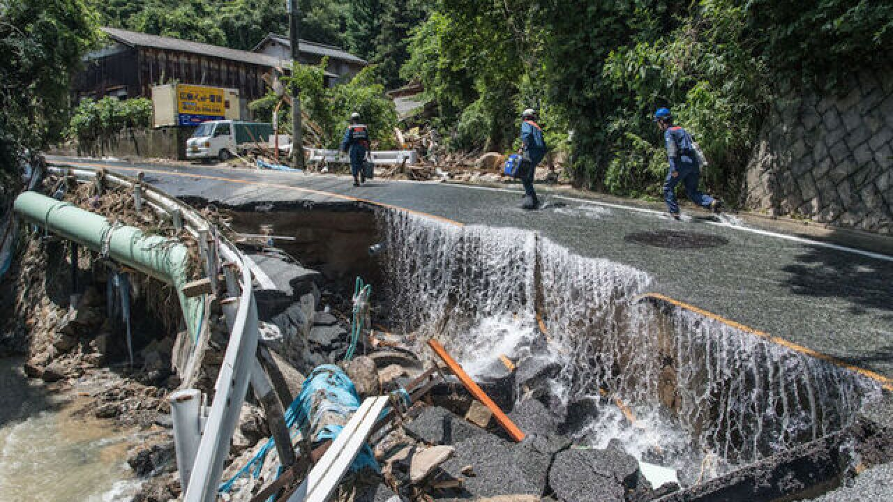 Japan floods: At least 122 dead after heavy rain and landslides