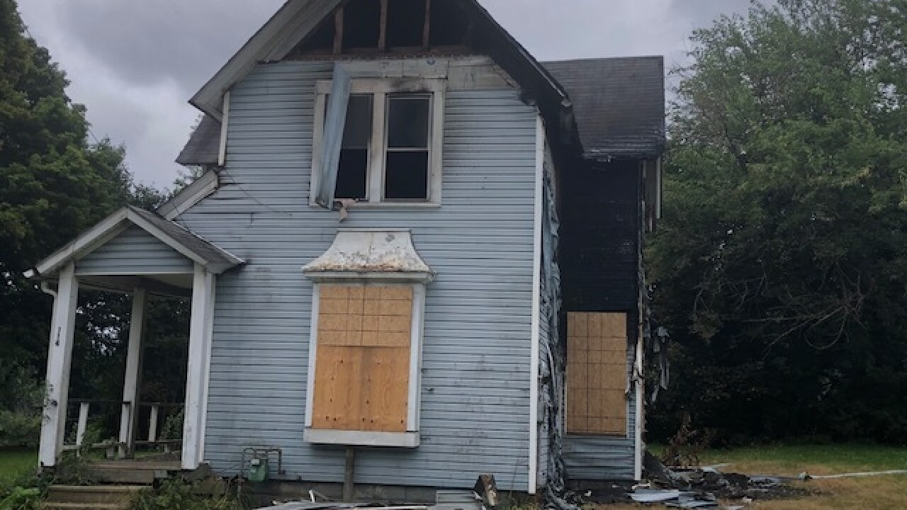Fire bomb tossed into house, Akron woman burned