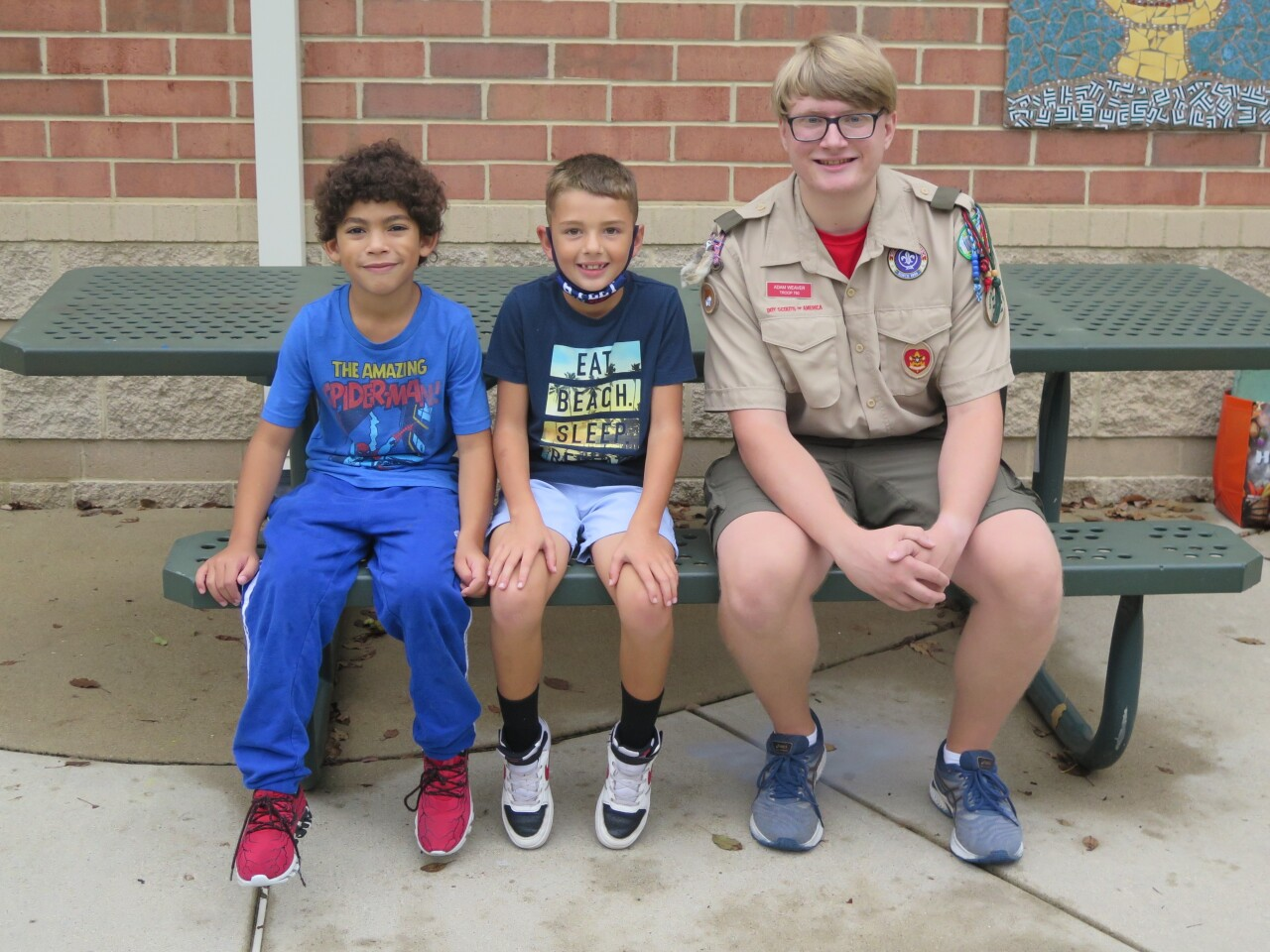 From left, Kamdyn Crump, Dallas Meeker and Adam Weaver pose for a photo.