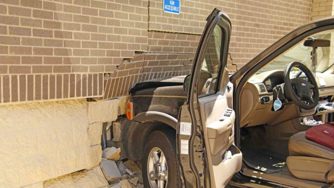 Woman's Brakes Fail, Crashes Into Store