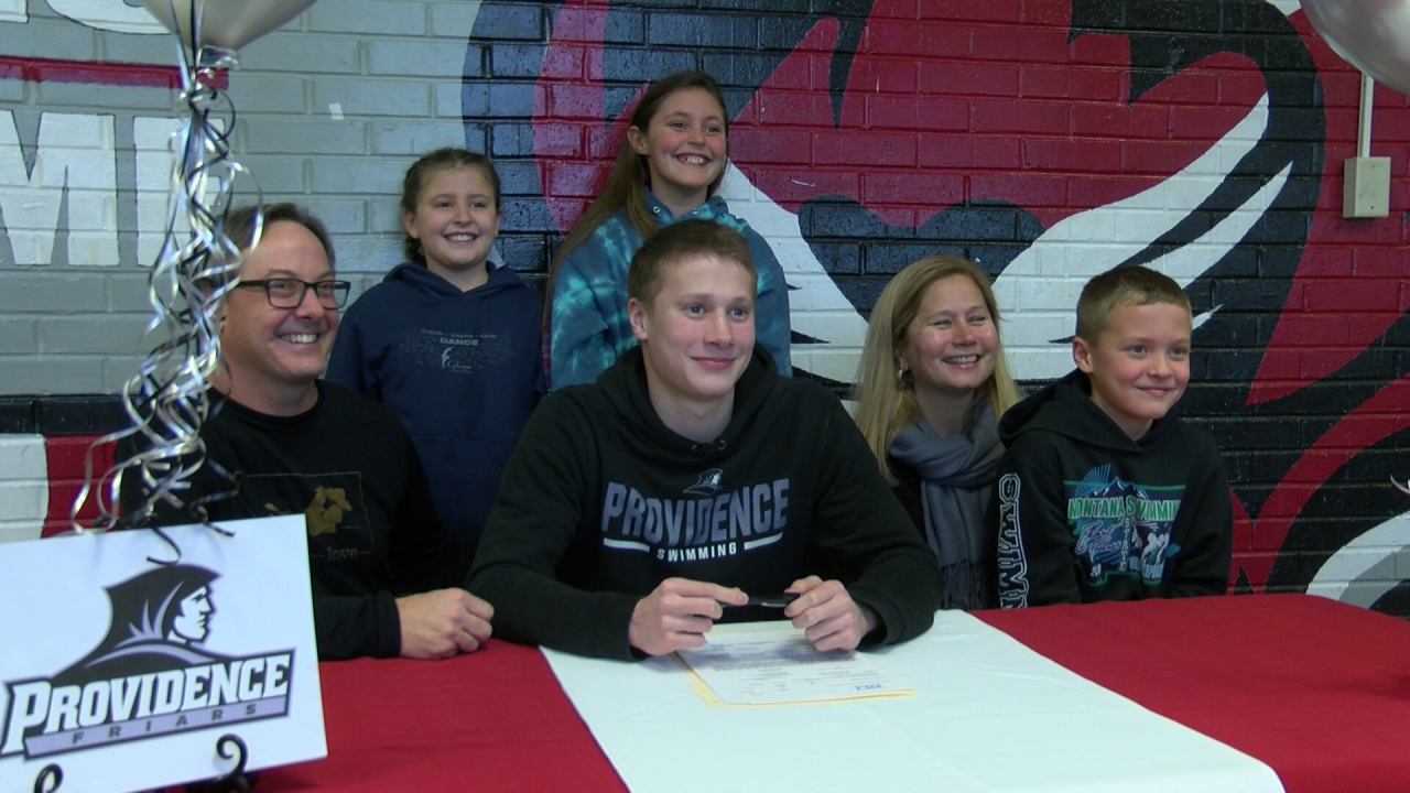 Keller signs with Providence College for swimming